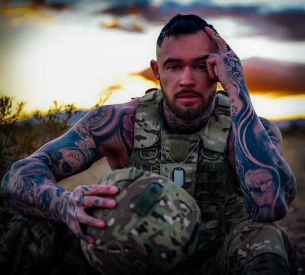 US Marine sitting in gear sunset